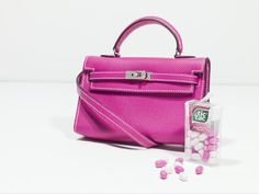 HERMÈS, 2011 a rose tyrien epsom leather tiny kelly bag