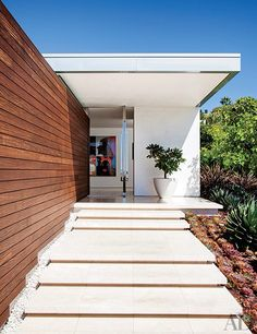 Create a grand entrance.  A wide and deep step, vibrant greenery, sky views, raw materials and mixing sheen levels.