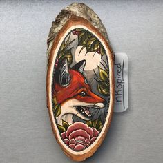 Wood slice with an original drawing of a fox and door Inkspirednl