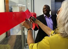 Tshililo Michael Masutha, South Africa's deputy minister of science and technology, participates in cutting the ribbon during the opening ceremony of  the Cape Town HVTN Immunology Laboratory on Oct. 23, 2013 in Cape Town, South Africa. Photo by Robert Hood, Fred Hutchinson Cancer Research Center.