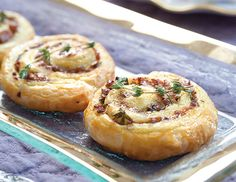 Ground pork, mushrooms, and a honey-mustard sauce combine to make Pork and Mushroom Puff Pastry Swirls, a delicious teatime savory.