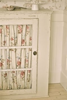 Love the fabric inside the doors - have been wanting to do this with my antique gun cabinet!