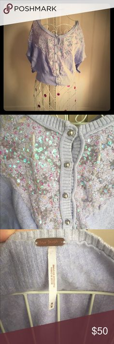 Free People vintage style lavender shrug sweater This gorgeous Free People sharing will add a special feminine and vintage appeal to any outfit, from jeans and a white t-shirt to a cocktail dress. Beautiful soft lavender cropped sweater, floral iridescent sequined detail, silver ball buttons, wide portrait neckline. This sweater is amazing in every little detail. Gently worn with no flaws. Free People Sweaters Shrugs & Ponchos