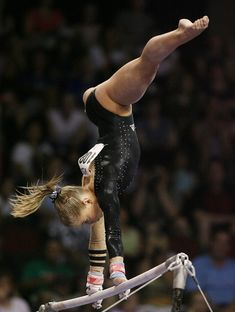 Shawn Johnson competes on the uneven bars