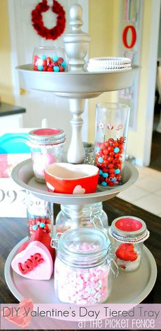 DIY tiered tray from At The Picket Fence, made from Dollar Tree trays.