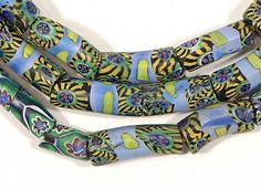 Antique Venetian glass peacock elbow beads used in the Africa trade circa late 1800's, early 1900's.