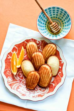 Orange Honey Madelines:  Ingredients  3/4 cup all-purpose flour  1/2 tsp. baking powder  1/8 tsp. kosher salt  2 large eggs  1/3 cup of sugar  2 Tbsp. honey  2 tsp. vanilla extract  1/2 tsp. finely grated orange zest  5 Tbsp. unsalted butter, melted, cooled, plus more for molds  madeleine pan