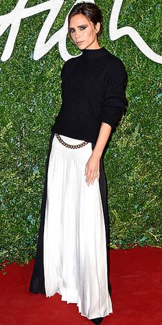 VICTORIA BECKHAM What do you wear when your own line is about to win Best Brand at the BFAs in London? It's not even a question. Victoria wears a black-and-white skirt from her Fall 2014 collection with a chain detail at the waist.