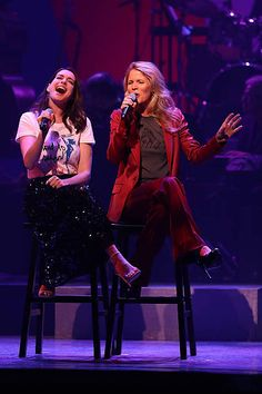 Anne Hathaway and Kelli O'Hara perform during the Hillary Victory Fund Stronger Together concert at St James Theatre on October 17 2016 in New York...