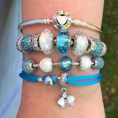 Watery blue Pandora for #bluejuly2017 and a stroll with ice cream along the shores of Victoria Lake in Stratford. #pandora #mypandora #myarmparty #aqua #blue #crystals #murano #glassbeads #pandorabeads #DOPANDORA #dosummer #bdfrnz #pandoraessence #doinspire #podora @visitstratfordon #sarah #stacknado