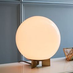 """Globe Table Lamp: Medium: 11""""diam. x 12.4""""h.  Large: 14""""diam. x 16""""h.  Cord length: 8'.  Accommodates a 13W CFL bulb or a 60W incandescent bulb.  Inline On/Off switch on cord.  UL listed."""