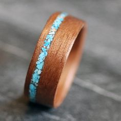 ON SALE Walnut with Crushed Turquoise Inlay Bentwood Wooden Ring. $159.00, via Etsy.
