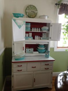 I love this Hoosier Cabinet....with all the vintage Pyrex so cute