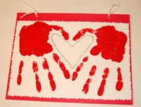 Valentine's heart made with two handprints.