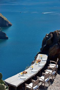 Eating breakfast by the caldera of Santorini, Greece