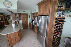 With custom wine rack integrated in the kitchen.