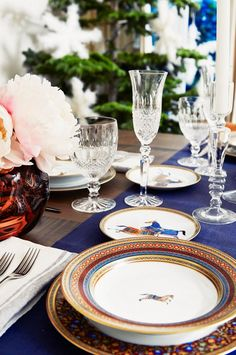 Elegant crystal glasses and chic colorful Hermes plates
