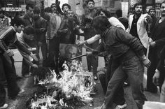IRAN. Tehran. December 1978. Rioters burn a portrait of the SHAH as a sign of protest against his regime.© A. Abbas/Magnum Photos