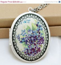 Forget Me Not Flower Locket.. I would love to put a picture of me pregnant and her last ultrasound inside.