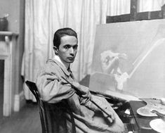Joe Leyendecker in his studio with one of his drawings,perhaps of his lover & model for hundreds of magazine covers,  Charles Beach