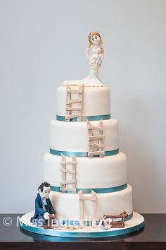 A special four tiered wedding cake by Miss Ingredient Cake Company.