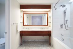Symmetrical, simple design with modern wood accents for the contemporary bathroom at Grand Hyatt Kauai with chrome shower and faucets. Grand Hyatt Kauai, Wood Accents, Shower Faucet, Faucets, Contemporary, Modern, Simple Designs, Showers, Chrome