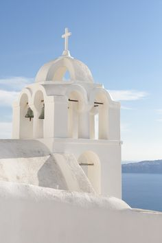 White church tower in Oia - Santorini, Greece
