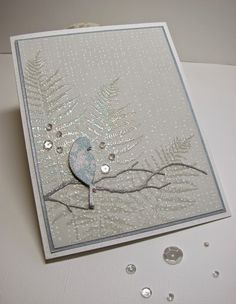 Let Heaven and Nature Sing Hero Arts Tiny Ink Spots embossed in white on PTI soft stone CS. Silhouette Fern stamps with HA sparkle embossing powder