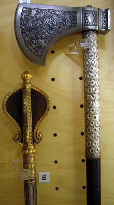 Indian shishpar (flanged mace), mughal, 18th century, steel head and shaft inlaid with gold, and tabar-zin (saddle axe), Lucknow, 18th century,  chiselled steel head, ebony shaft covered with chased silver.