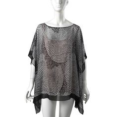 This monochromatic black and white silk flowing top - called our Japanese Chrysanthemums Sheer Poncho - is a perfect look for spring and summer and can be layered or worn on its own. Inspired by an Edo period stencil from the @metmuseum collection.