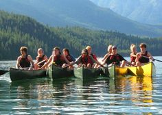 Canoeing!  Used to do this with our campers at Camp DeBruce.....we'd make lunch on the water, and just pass the sandwiches [made to order] down the line...