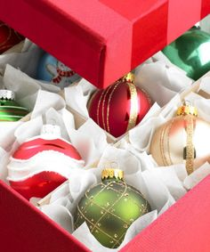 Be mindful of where you're storing items. Wreaths, artificial trees and some ornaments are fine to store in a garage or attic. Choose sturdy plastic boxes that can be stacked or bags you can hang on the wall to protect items against dust, dirt and bugs.