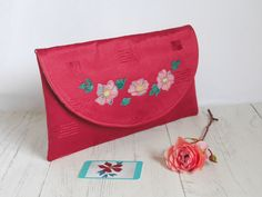 This unique envelope-style clutch is made from upcycled fabric which has a luxurious sheen to it.  On the flap there's an appliqued design based on wild roses. Red Clutch, Clutch Bag, Occasion Bags, Floral Clutches, Red Envelope, Printed Cotton, Special Occasion, Upcycle, Cotton Fabric