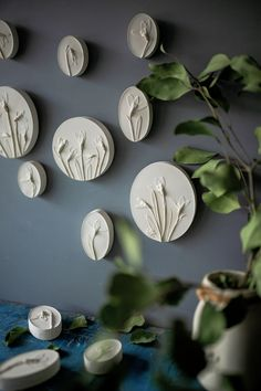 Botanical bas-reliefs set of 3 oval plates by DinaArtDecor. Snowdrops flowers wall decor kit in french country dinner room. White round floral plaster cast. The botanical panel is ideal for decorating the entrance hall, living room, kitchen, bedroom or baby room. You can combine several bas-reliefs into one composition. These panels are an amazing gift for nature lovers #botanicalbasrelief #wallart #kitchenwalldecorideas