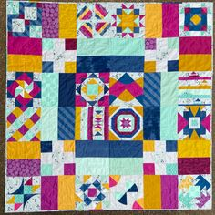 Summer Sampler Three Ways – part 2 | crossquilt Royal Colors, Vibrant Colors, Perfect Triangles, Straight Line Quilting, Triangle Print, Sampler Quilts, Nine Patch, Third Way, Grey Fabric
