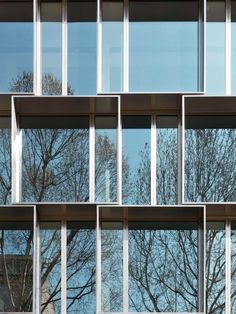 3.6×3.6m stainless steel slat in a staggered while  another façade made from GRC panels repeated size