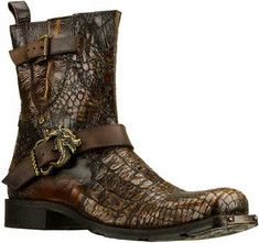 Show some sweet soul in the Mark Nason Redding boot.Premium snake embossed and distressed smooth leather in a tall ankle height casual boot, with squared toe, laser etched dragon design, straps with metal dragon buckle and belted center panel.Full length side zipper with metal zipper pull, smooth le