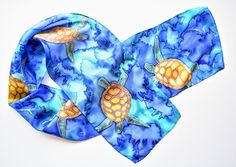 Sea Turtle Splash, inch Habotai silk, hand-painted using the serti / resist method. Find more scarves on Etsy! Painted Silk, Hand Painted, Turtle Swimming, Silk Scarves, Shades Of Blue, Handmade Items, Sea, Painting, Etsy