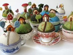 Wow - a whole town! The pin cushions from Mimi Kirchner are made on top of a solid wool felt ball and are glued into a teacup.The details are all hand embroidered.