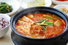 In this post, I'm updating my kimchi jjigae post that was originally posted in September 2009 with better photos and new head notes.   When kimchi gets old, it becomes an excellent ingredient for various other dishes! The most common dish made with aged kimchi is kimchi jjigae (김치 찌개). It's a go-to stew in Korean homes. Growing up …