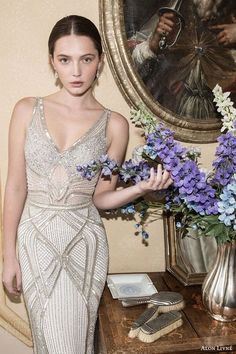 Go bold and lux with this figure hugging, architectural wedding gown.