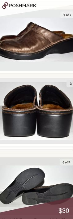 Darma Bronze Mule Clog Shoe Size 40 CONDITION: Pre-owned and stored in a smoke free / dog friendly home. Normal wear from use as pictured such as light scuffing, marks, sole, and footbed wear.  Some label residue in footbed as pictured.    DETAILS:  The Darma is a great everyday clog with a padded instep for extra comfort & inside gore for adjustability. The Darma features technical lining at the front of the toe box which provides comfort, warmth & absorbs moisture. NAOT Shoes Mules & Clogs