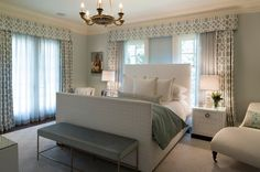 smart way to address pair of windows behind a bed, single valance, panels on edges, layers layers layers