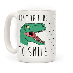 "This sassy feminist dinosaur mug reads, ""Don't Tell Me To Smile"" an features an angry raptor ready to tear the head off of any misogynist getting in her way! Use this dino coffee mug to let everyone know that they better think twice before telling you to smile!"