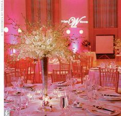 The pink lighting washed the room with a warm glow, and centerpieces of dendrobium orchids overflowed their fluted silver vases.