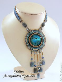 what a beautiful beaded necklace and pendant
