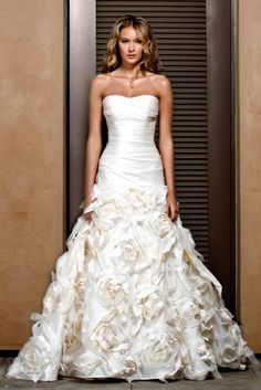 Technically this Jenny Lee wedding gown is my dream...it's got the amazing ruched bodice and textured rosette skirt of Sunday Rose, but the dropped waist that's more flattering.