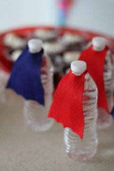 {DIY} Water Bottle Super Hero Capes | Verified Mom she 'eyeballed' the shape and size,( not much help)  They are felt.
