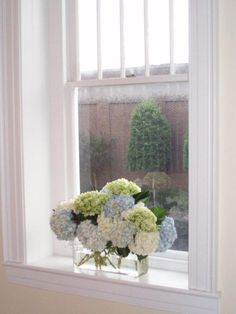 A simple arrangement of different colored hydrangeas. The perfect touch to add some color to this window sill!