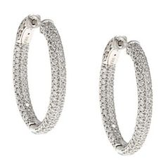 @Overstock - This pair of sterling silver hoop earrings has beautiful rhodium plating with a highly polished finish. With pave cubic zirconia set on the inside and outside of the hoops, these earrings feature a locking clip-in clasp. http://www.overstock.com/Jewelry-Watches/White-Rhodium-Silver-Oval-Pave-Cubic-Zirconia-Hoop-Earrings/5784892/product.html?CID=214117 $94.99